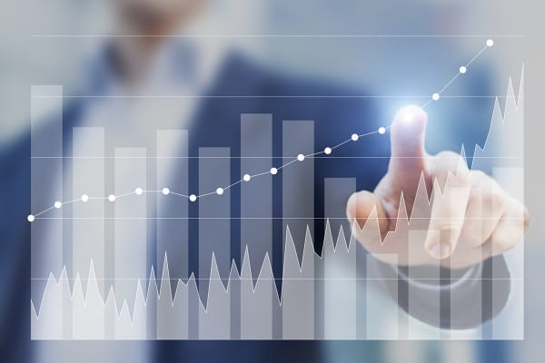 Expert businessman using business intelligence to sketch future growth and success with charts